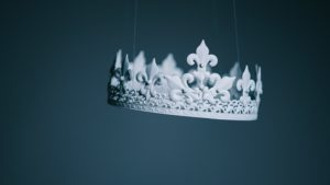 paper crown suspended in the air