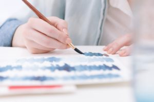 Person painting with watercolors