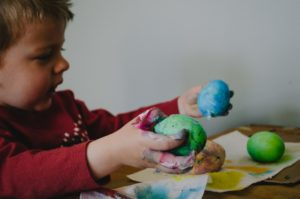 little boy playing with play dough
