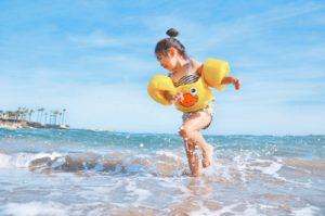 young girl dance in ocean tide