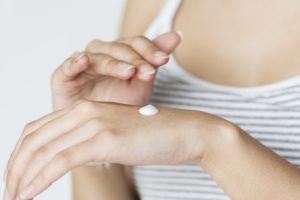 women with lotion on hand