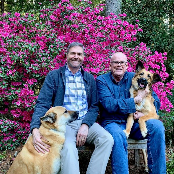 Brian McCann and Tom Costales with their dogs Muuki and Harper Lee. Courtesy of Brian McCann